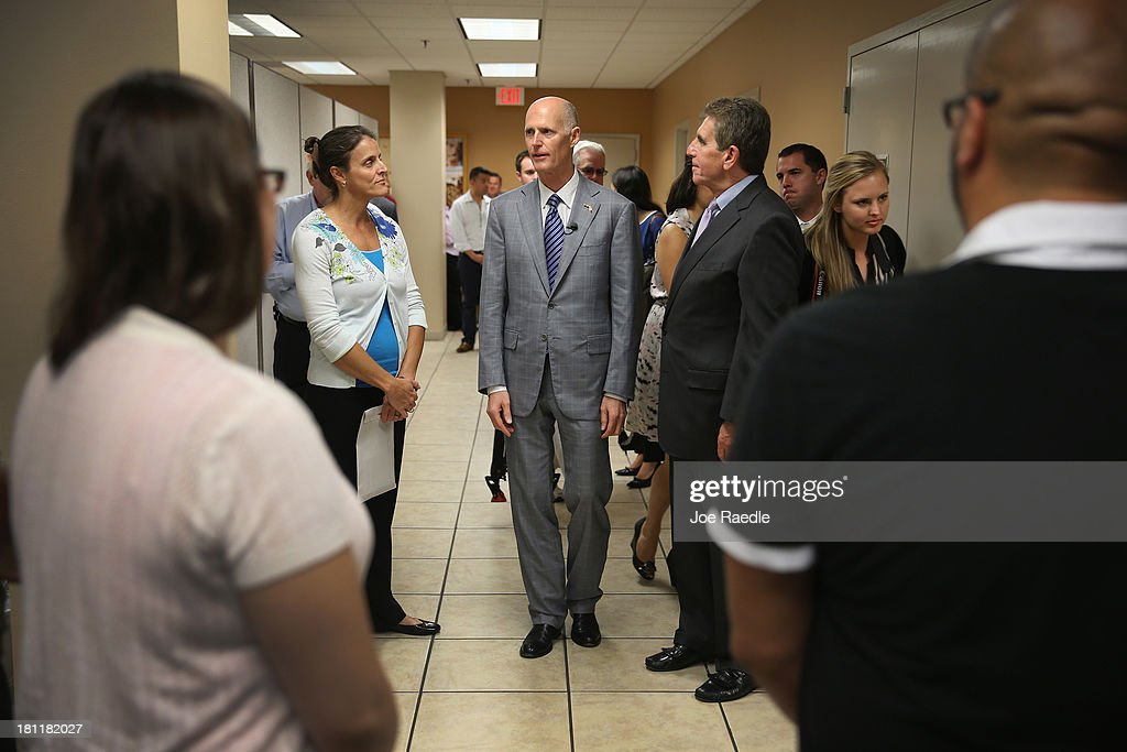 Florida Governor Rick Scott arrives for a town hall meeting with the Agency for Persons with Disabilities (APD) at the Spelios Center, one of Sunrise Groups adult day training centers, to discuss issues impacting the greater disabilities community on September 19, 2013 in Miami, Florida. The Florida Governor leads the state that has refused to set up its own health care exchange in preparation for the Affordable Care Act, which is set to begin enrollment on October 1. Republican leaders in Florida have also highlighted concerns about the navigators, federally funded workers who will help enroll people in health plans.
