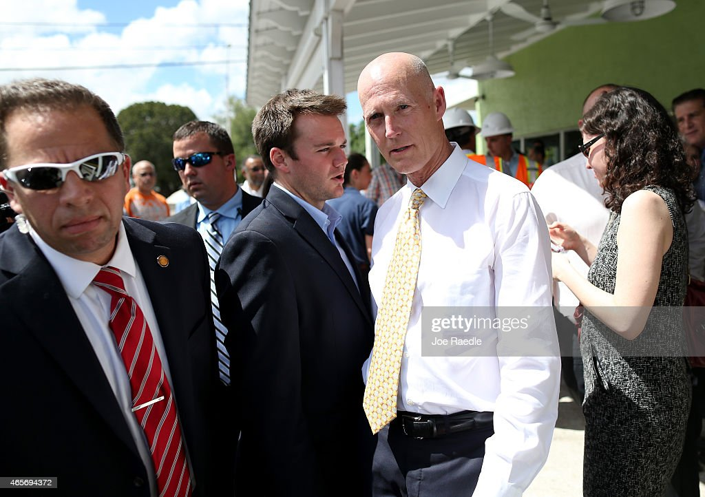 Florida Governor <a gi-track='captionPersonalityLinkClicked' href=/galleries/search?phrase=Rick+Scott+-+Politiker&family=editorial&specificpeople=2370892 ng-click='$event.stopPropagation()'>Rick Scott</a> (2nd R) attends a road expansion event at the Casa Maiz restaurant where he fieldeds questions from reporters about climate change on March 9, 2015 in Hialeah, Florida. Recent reports indicate that the Florida governor allegedly issued orders for certain state agencies to not to use the term 'climate change' or 'global warming' in any official communications, emails, or reports.