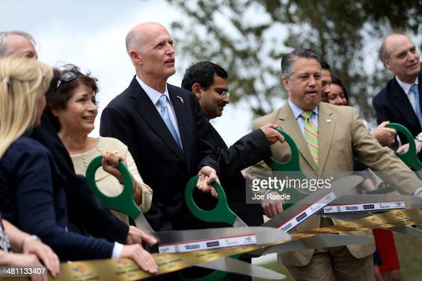 Florida Governor Rick Scott attends the ribbon cutting for the opening of a I595 Express Project on March 28 2014 in Davie Florida The Governor finds...