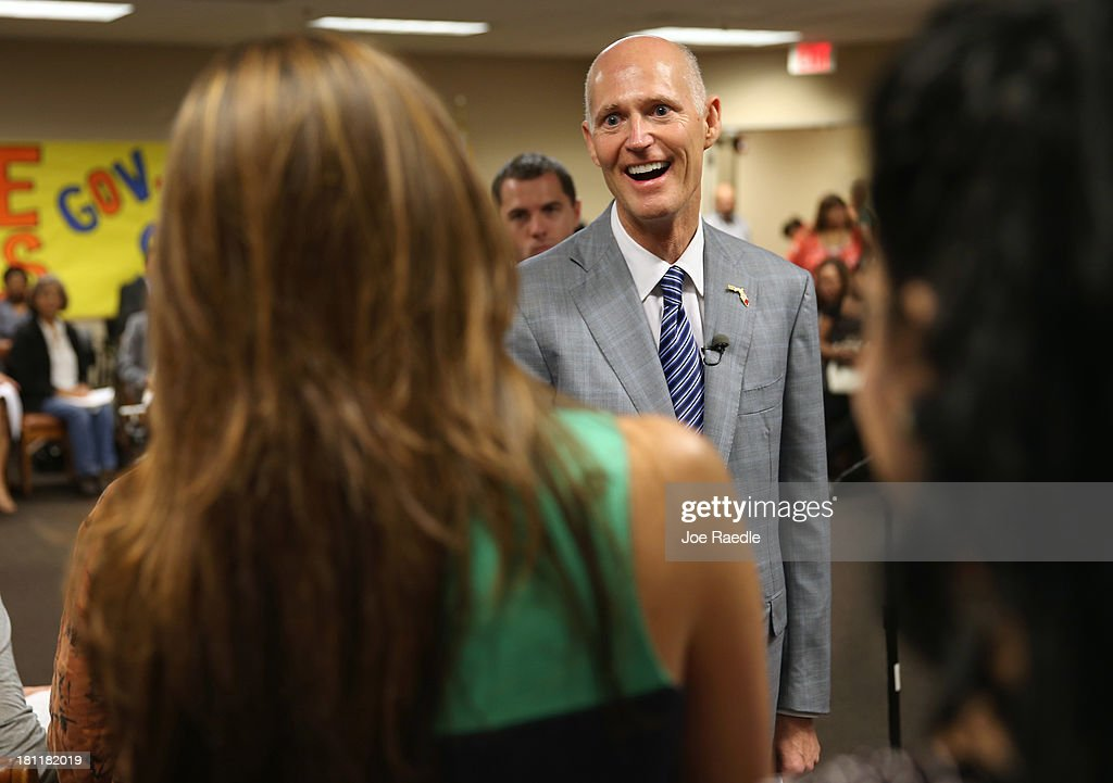 Florida Governor Rick Scott greets people as he arrives for a town hall meeting with the Agency for Persons with Disabilities (APD) at the Spelios Center, one of Sunrise Groups adult day training centers, to discuss issues impacting the greater disabilities community on September 19, 2013 in Miami, Florida. The Florida Governor leads the state that has refused to set up its own health care exchange in preparation for the Affordable Care Act, which is set to begin enrollment on October 1. Republican leaders in Florida have also highlighted concerns about the navigators, federally funded workers who will help enroll people in health plans.