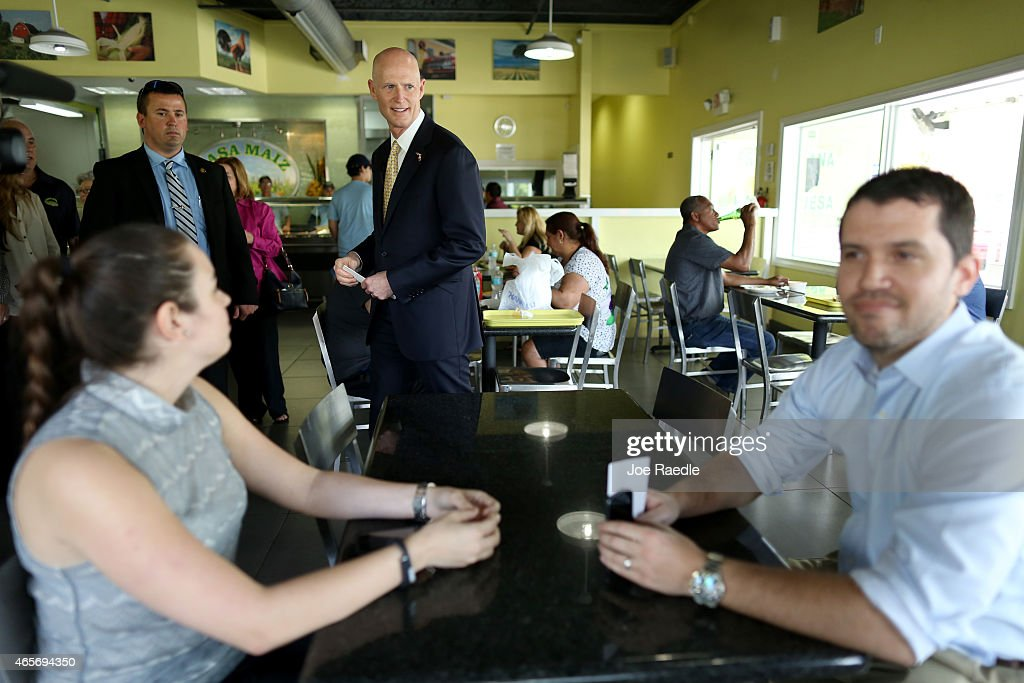 Florida Governor <a gi-track='captionPersonalityLinkClicked' href=/galleries/search?phrase=Rick+Scott+-+Pol%C3%ADtico&family=editorial&specificpeople=2370892 ng-click='$event.stopPropagation()'>Rick Scott</a> (C) greets people as he attends a road expansion event at the Casa Maiz restaurant where he fielded questions from reporters about climate change on March 9, 2015 in Hialeah, Florida. Recent reports indicate that the Florida governor allegedly issued orders for certain state agencies to not to use the term 'climate change' or 'global warming' in any official communications, emails, or reports.