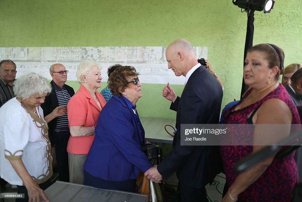 Florida Governor <a gi-track='captionPersonalityLinkClicked' href=/galleries/search?phrase=Rick+Scott+-+Pol%C3%ADtico&family=editorial&specificpeople=2370892 ng-click='$event.stopPropagation()'>Rick Scott</a> (2nd R) greets people as he attends a road expansion event at the Casa Maiz restaurant where he fielded questions from reporters about climate change on March 9, 2015 in Hialeah, Florida. Recent reports indicate that the Florida governor allegedly issued orders for certain state agencies to not to use the term 'climate change' or 'global warming' in any official communications, emails, or reports.