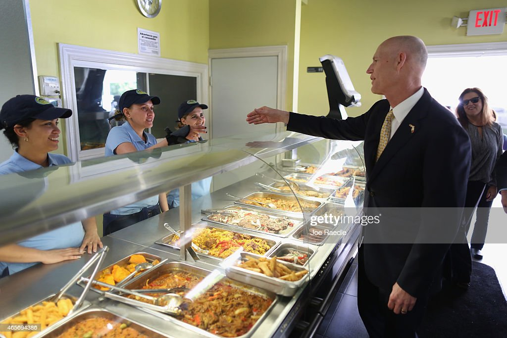 Florida Governor <a gi-track='captionPersonalityLinkClicked' href=/galleries/search?phrase=Rick+Scott+-+Pol%C3%ADtico&family=editorial&specificpeople=2370892 ng-click='$event.stopPropagation()'>Rick Scott</a> (4th L) greets workers as he attends a road expansion event at the Casa Maiz restaurant where he fielded questions from reporters about climate change on March 9, 2015 in Hialeah, Florida. Recent reports indicate that the Florida governor allegedly issued orders for certain state agencies to not to use the term 'climate change' or 'global warming' in any official communications, emails, or reports.