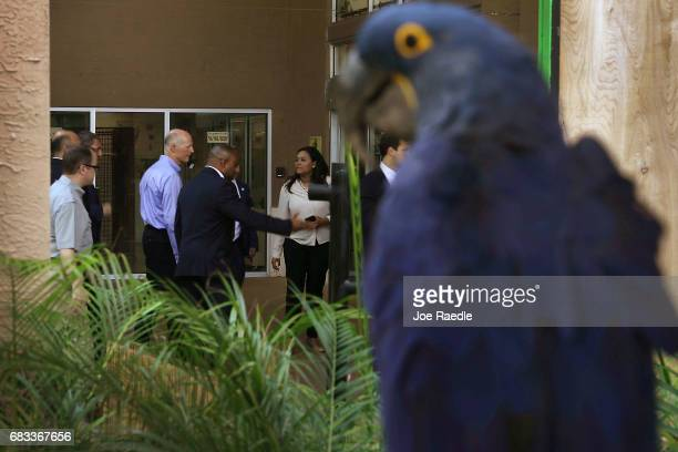 Florida Governor Rick Scott leaves Jungle Island after making an announcement that the number of tourists visiting the state for the first three...