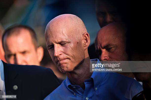 Florida Governor Rick Scott listens during a press conference near the Pulse nightclub June 13 2016 in Orlando Florida Fortynine people and the...