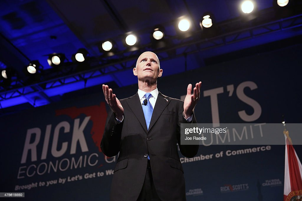 Florida Governor Rick Scott makes an introductory statement before the start of the Rick ScottÕs Economic Growth Summit held at the Disney's Yacht and Beach Club Convention Center on June 2, 2015 in Orlando, Florida. Many of the leading Republican presidential candidates are scheduled to speak during the event.