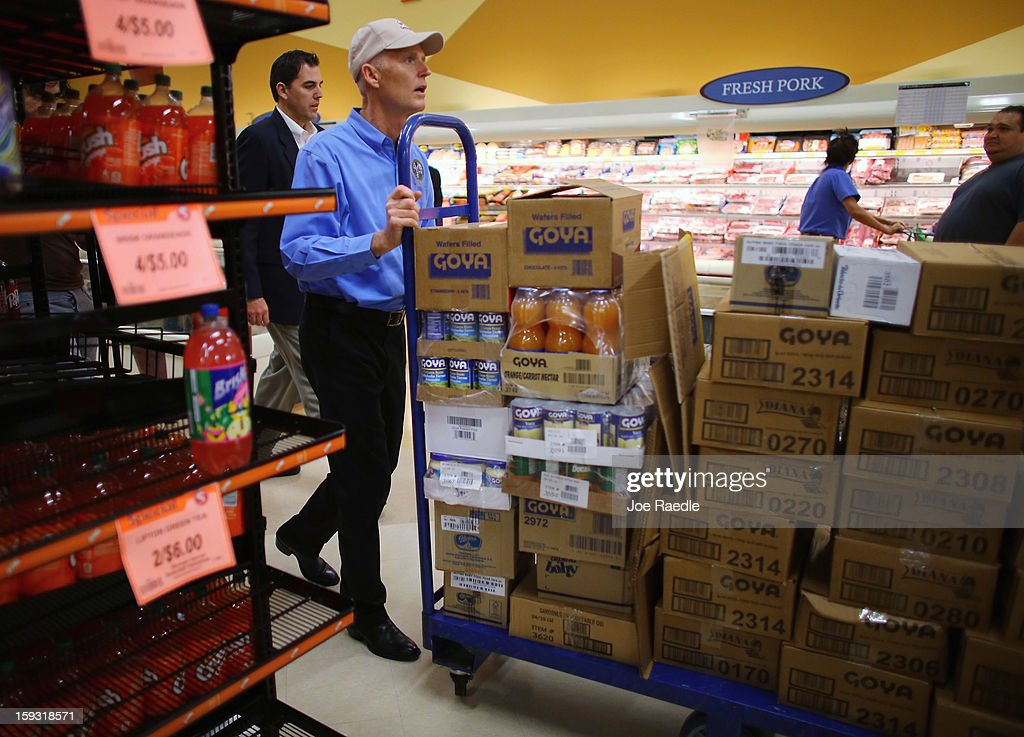 Florida Governor Rick Scott pushes Goya products on a cart as he helps stock the shelves at the Sedano's Supermarket on January 11, 2013 in Miami, Florida. Governor Scott spent his 15th 'Let's Get to Work Day' highlighting the importance of building up manufacturing jobs.
