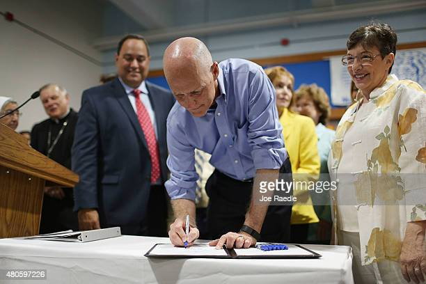 Florida Governor Rick Scott signs a Florida State bill as he visits the Marian Center which offers services for people with intellectual disabilities...