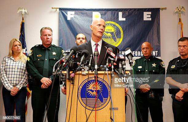 Florida Governor Rick Scott speaks at a press conference about the shooting at Club Blu on July 25 2016 in Fort Myers Florida Two people were killed...