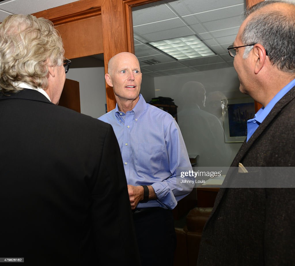 Florida Governor <a gi-track='captionPersonalityLinkClicked' href=/galleries/search?phrase=Rick+Scott+-+Politiek&family=editorial&specificpeople=2370892 ng-click='$event.stopPropagation()'>Rick Scott</a> (C) speaks during a news conference at Aerospace Precision before taking a tour of the facility to highlight job growth in Hollywood on Tuesday July 7, 2015 in Hollywood, Florida.