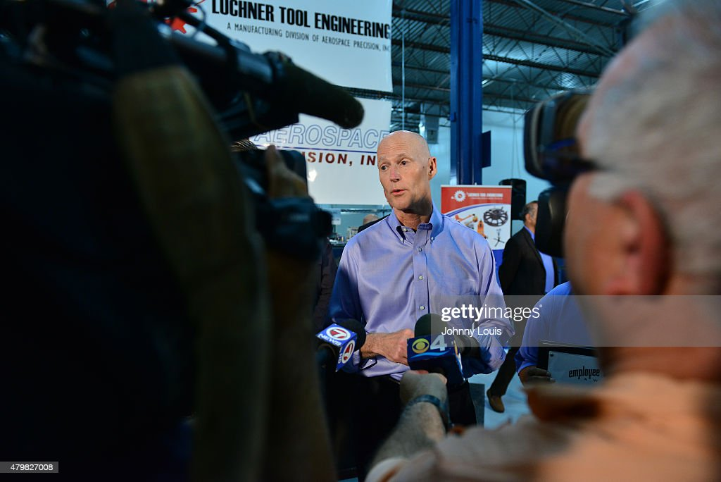 Florida Governor <a gi-track='captionPersonalityLinkClicked' href=/galleries/search?phrase=Rick+Scott+-+Politiek&family=editorial&specificpeople=2370892 ng-click='$event.stopPropagation()'>Rick Scott</a> (C) speaks during a news conference at Aerospace Precision after a tour of the facility to highlight job growth in Hollywood on Tuesday July 7, 2015 in Hollywood, Florida.