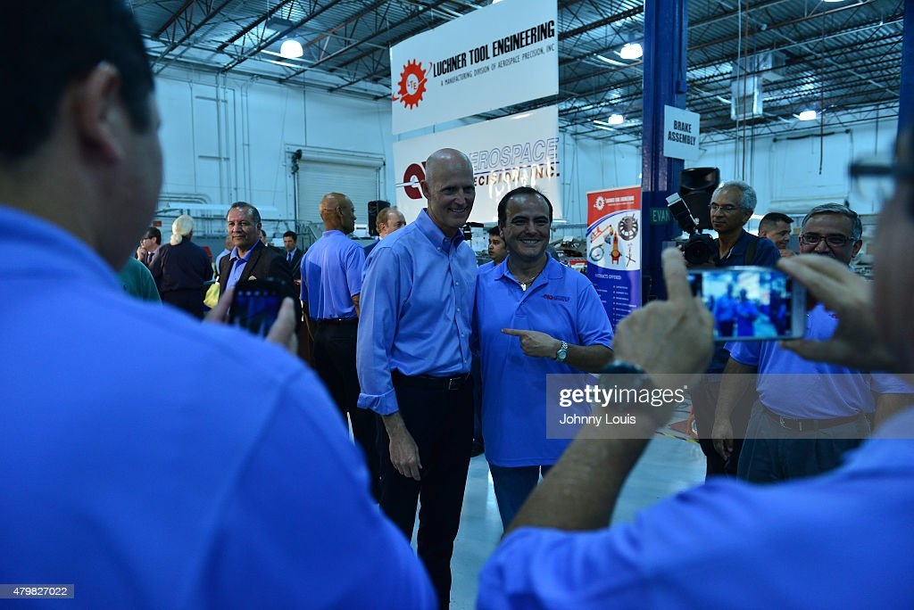 Florida Governor <a gi-track='captionPersonalityLinkClicked' href=/galleries/search?phrase=Rick+Scott+-+Politiek&family=editorial&specificpeople=2370892 ng-click='$event.stopPropagation()'>Rick Scott</a> (L) speaks during a news conference at Aerospace Precision after a tour of the facility to highlight job growth in Hollywood on Tuesday July 7, 2015 in Hollywood, Florida.