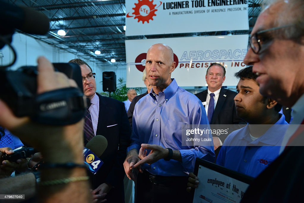 Florida Governor Rick Scott (C) speaks during a news conference at Aerospace Precision after a tour of the facility to highlight job growth in Hollywood on Tuesday July 7, 2015 in Hollywood, Florida.