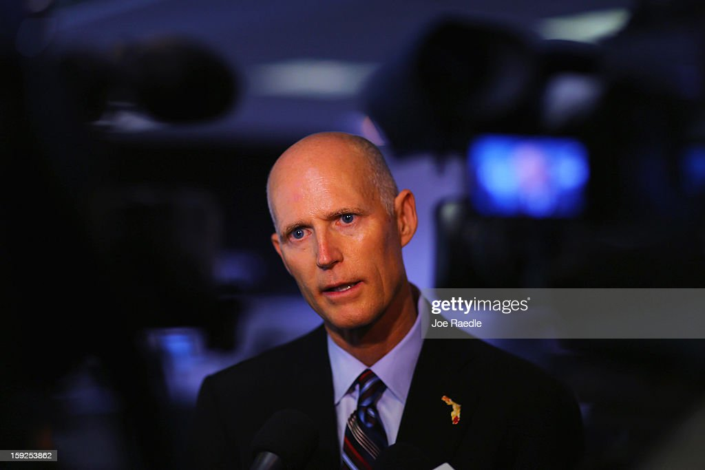 Florida Governor Rick Scott speaks to the media after he toured the manufacturing facility at Beckman Coulter, a biomedical laboratory instruments manufacturer, on January 10, 2013 in Miami, Florida. The governor continues his push to create new business opportunities in the state and earlier in the week announced a plan to call on the State Legislature to eliminate the sales tax on equipment purchased by companies for their production plants.
