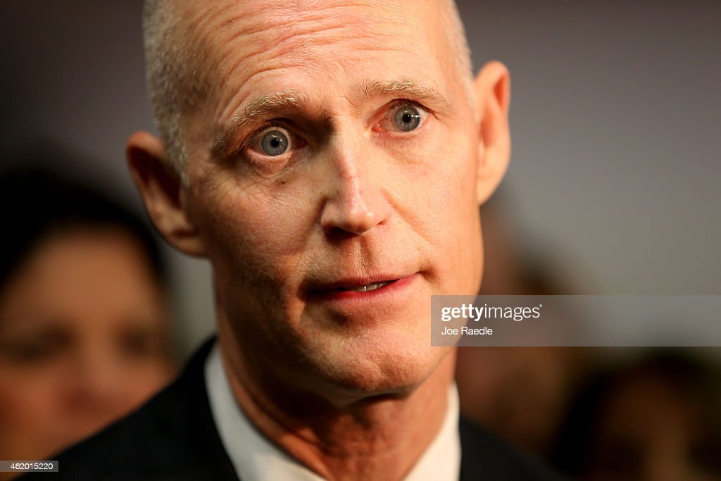 Florida Governor <a gi-track='captionPersonalityLinkClicked' href=/galleries/search?phrase=Rick+Scott+-+Politiek&family=editorial&specificpeople=2370892 ng-click='$event.stopPropagation()'>Rick Scott</a> speaks to the media during a visit to SeaLand shipping lines new Intra-Americas headquarters on January 23, 2015 in Miramar, Florida. Scott announced that Florida businesses added 11,500 private-sector jobs in December 2014 and since December 2010, Florida has added 728,500 private-sector jobs.