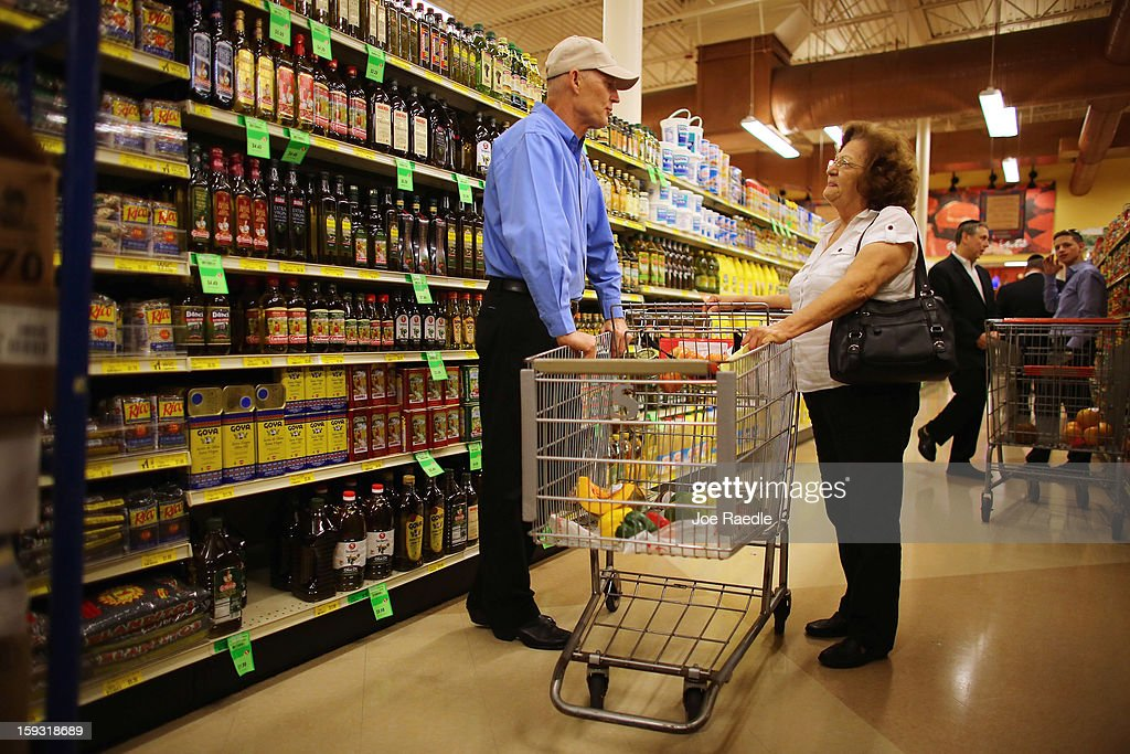 Florida Governor Rick Scott (L) speaks with Maria Socorro as he visits Sedano's Supermarket on January 11, 2013 in Miami, Florida. Governor Scott spent part of his 15th 'Let's Get to Work Day' stocking the shelves at the grocery store with Goya products as he highlights the importance of building up manufacturing jobs.