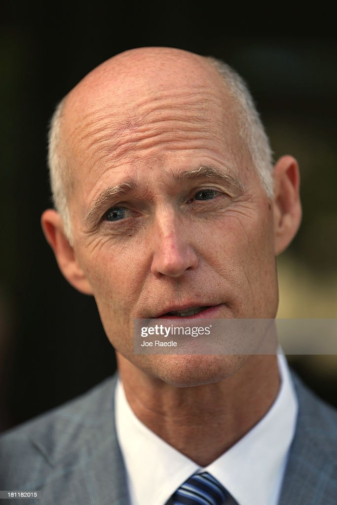 Florida Governor Rick Scott speaks with the media after attending a town hall meeting with the - florida-governor-rick-scott-speaks-with-the-media-after-attending-a-picture-id181182015