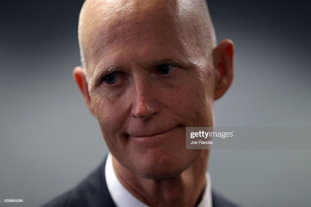 Florida Governor <a gi-track='captionPersonalityLinkClicked' href=/galleries/search?phrase=Rick+Scott+-+Politiek&family=editorial&specificpeople=2370892 ng-click='$event.stopPropagation()'>Rick Scott</a> speaks with the media as he attends a bill signing ceremony at the Department of Children and Families Southern Region office for a bill that helps individuals and families affected by mental illness and substance abuse on May 24, 2016 in Miami, Florida. It is hoped that the Florida bill will make it easier for persons with complex and persistent illnesses to obtain the services they need.