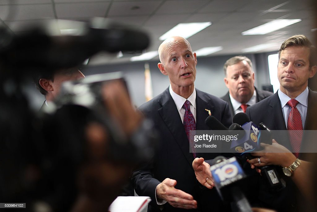Florida Governor <a gi-track='captionPersonalityLinkClicked' href=/galleries/search?phrase=Rick+Scott+-+Politician&family=editorial&specificpeople=2370892 ng-click='$event.stopPropagation()'>Rick Scott</a> speaks with the media as he attends a bill signing ceremony at the Department of Children and Families Southern Region office for a bill that helps individuals and families affected by mental illness and substance abuse on May 24, 2016 in Miami, Florida. It is hoped that the Florida bill will make it easier for persons with complex and persistent illnesses to obtain the services they need.