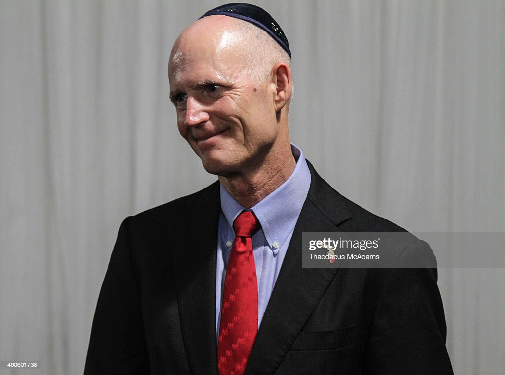 Florida Governor <a gi-track='captionPersonalityLinkClicked' href=/galleries/search?phrase=Rick+Scott+-+Politiek&family=editorial&specificpeople=2370892 ng-click='$event.stopPropagation()'>Rick Scott</a> visits the Chabad of South Broward on December 17, 2014 in Hallandale, Florida.