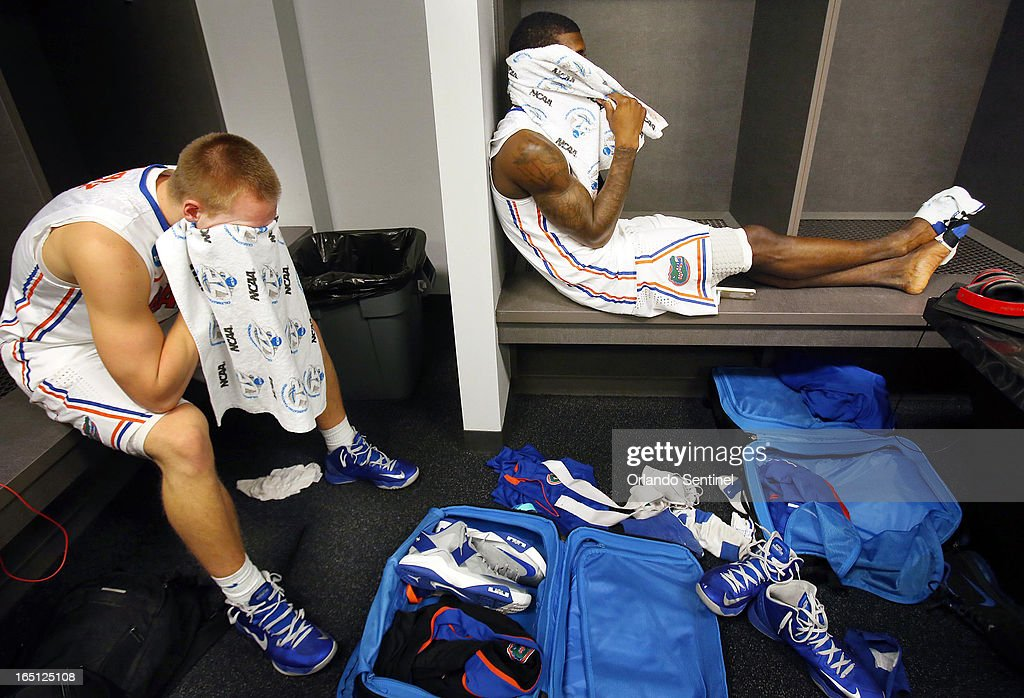 Florida guard Jacob Kurtz, left, and forward Casey Prather sit dejected in the locker room following the Gators' game against Michigan during the men's NCAA Tournament at Cowboys Stadium in Arlington, Texas, Sunday, March 31, 2013. Michigan won, 79-59.