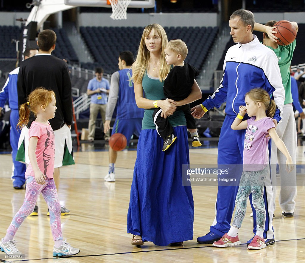 Florida Gulf Coast head coach Andy Enfield and his wife, Amanda, along with daughters Aila and Lily and son Marcum, step onto the court for a photo during practice at Cowboys Stadium in Arlington, Texas, on Thursday, March 28, 2013. The Eagles meet Florida in the NCAA Tournament on Friday.