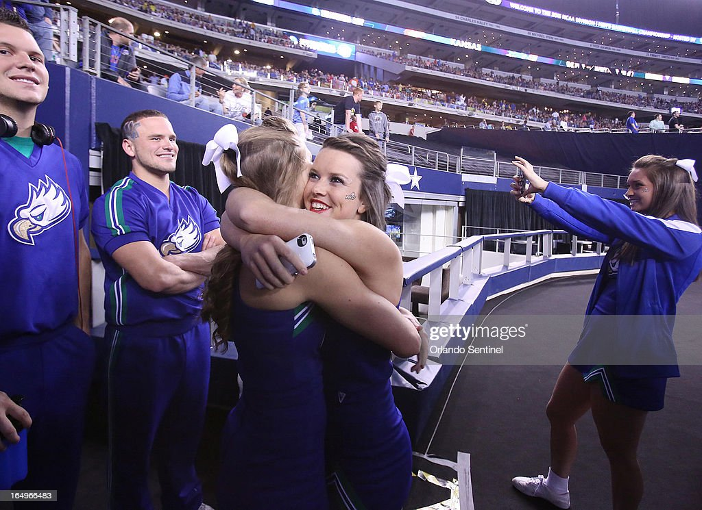 Florida Gulf Coast University cheerleaders drink in the moment as they step into the arena before the start of play against Florida in the NCAA Tournament's Sweet 16 game at Cowboys Stadium in Arlington, Texas, on Friday, March 29, 2013.