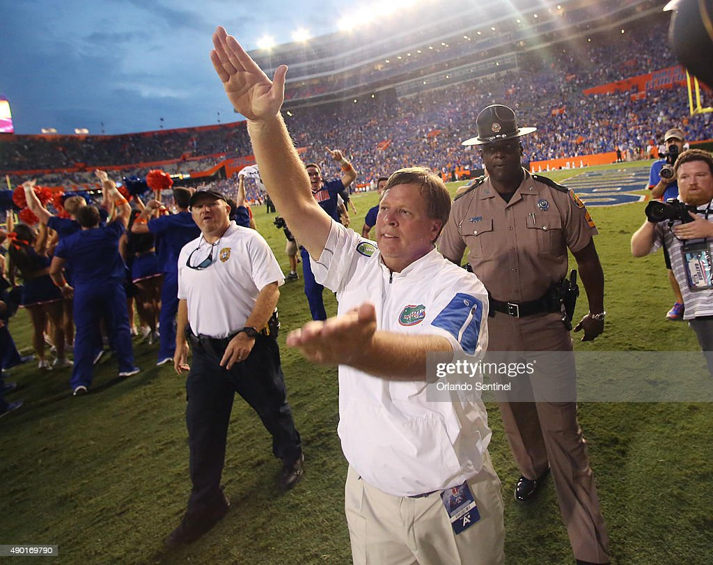 Florida head coach Jim McElwain celebrates by doing the Gator Chomp after a 2827 win against Tennessee at Ben Hill Griffin Stadium in Gainesville Fla...