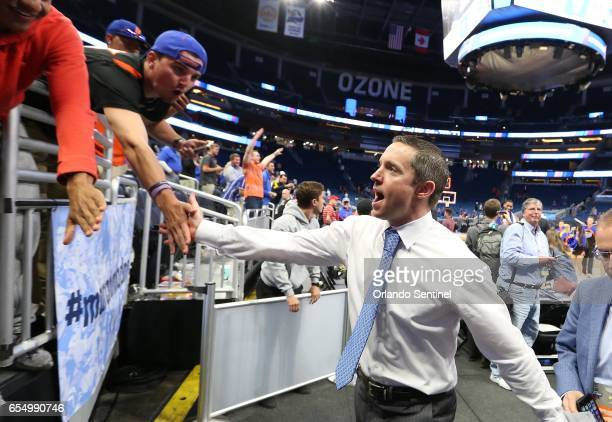 Florida head coach Mike White celebrates with fans after a 6539 win against Virginia during the second round of the NCAA Tournament at the Amway...