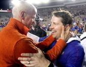 Florida head coach Will Muschamp right is congratulated by Florida athletic director Jeremy Foley left after the game at Doak Campbell Stadium in...