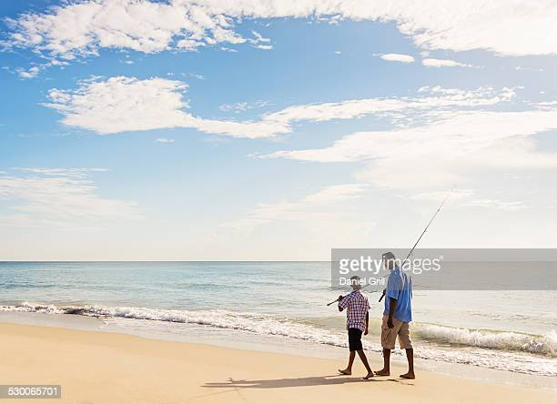 USA, Florida, Jupiter, Father and son (10-11) fishing