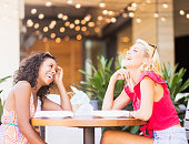 USA, Florida, Jupiter, Female friends laughing in street cafe