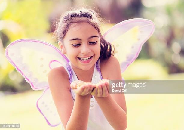 USA, Florida, Jupiter, Girl (8-9 ) holding fairy dust in hands