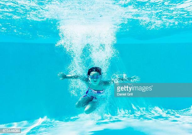 USA, Florida, Jupiter, Girl ( 8-9 ) swimming