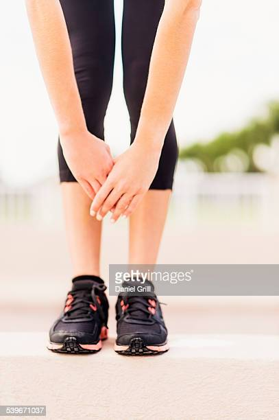 USA, Florida, Jupiter, Legs of exercising woman
