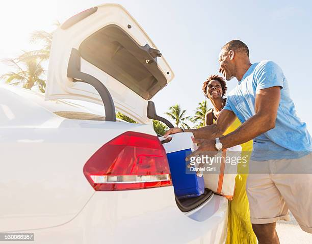 USA, Florida, Jupiter, Mature couple loading car trunk