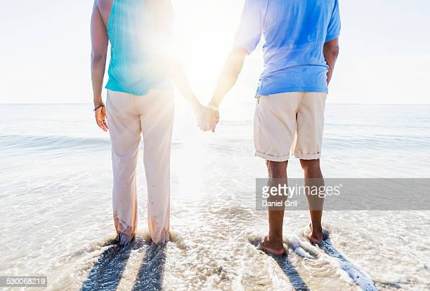 USA, Florida, Jupiter, Mature couple standing in sea