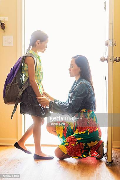USA, Florida, Jupiter, Mom holding hands with her daughter (6-7) at front door