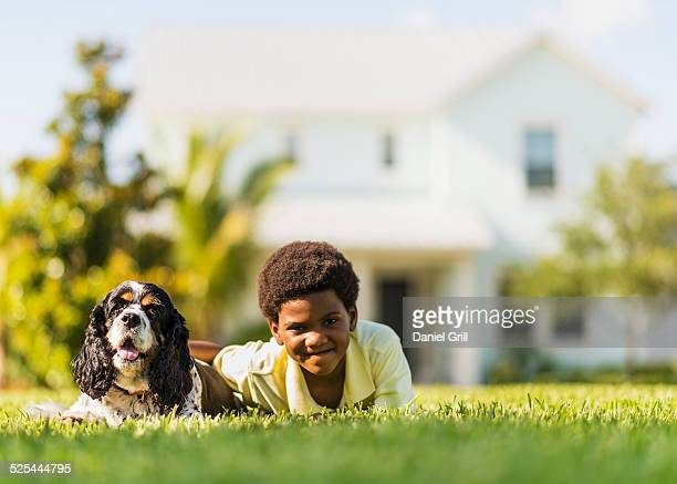 USA, Florida, Jupiter, Portrait of boy (6-7 ) with dog