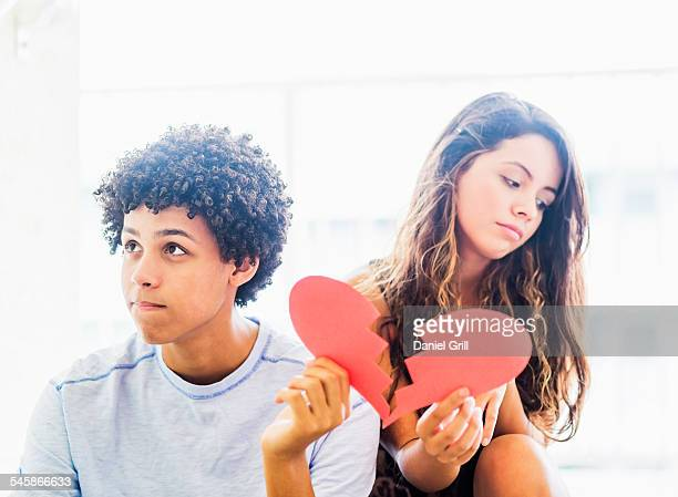 USA, Florida, Jupiter, Portrait of young couple with broken heart made from paper