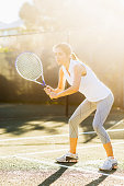 USA, Florida, Jupiter, Portrait of young woman playing tennis in outdoor court