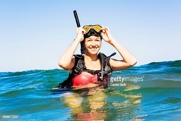 USA, Florida, Jupiter, Portrait of young woman scuba-diving in sea
