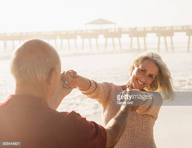 USA, Florida, Jupiter, Senior couple dancing on beach