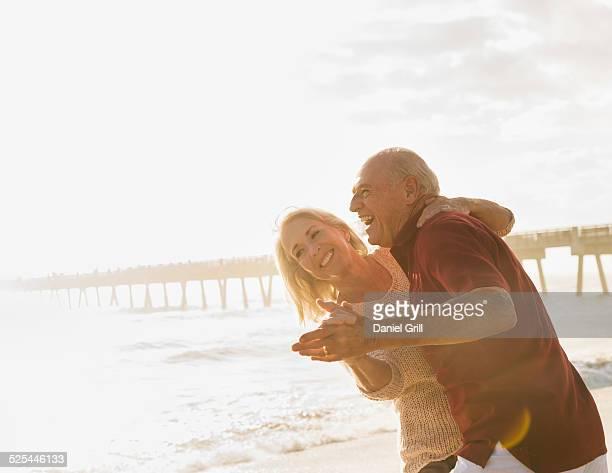 USA, Florida, Jupiter, Senior couple dancing on beach