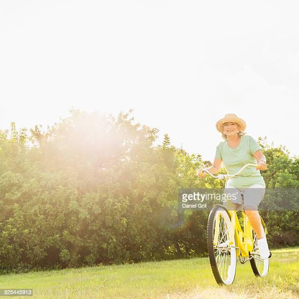 USA, Florida, Jupiter, Senior woman on bike