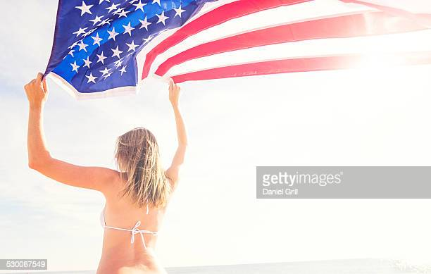 USA, Florida, Jupiter, Woman holding American flag