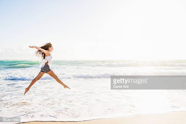 USA, Florida, Jupiter, Woman jumping on beach