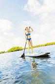 USA, Florida, Jupiter, Woman on paddle board