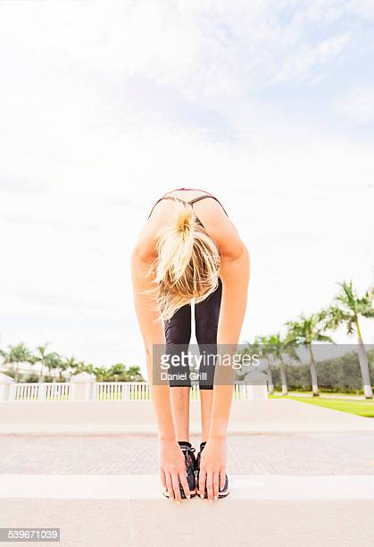 USA, Florida, Jupiter, Woman reaching for toes