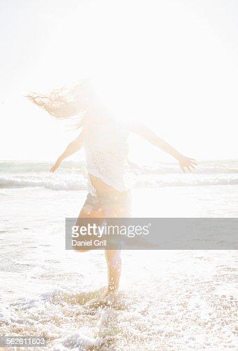 USA, Florida, Jupiter, Woman standing on one leg in sea